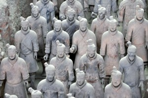 The Terra-cotta Warriors in Xi'An are entombed replicas of the warriors used by Qin Shi Huang to conquer his six neighbors and create the first Chinese  dynasty.