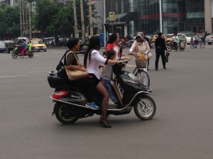 It's tough to text with your mother and daughter riding on your scooter. But is that all bad? At least you have to pay attention.