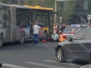 The worst accidents, of course, involve pedestrians or cyclists.  In this case a man on a scooter was clipped by a city bus.  He's sitting on the ground next to the bus.  He doesn't appear to be seriously hurt but he will right there until the police come and negotiations begin.