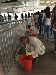 Cleaning the floors in a Beijing subway station.