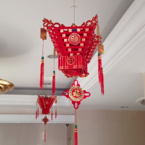 The color red is ubiquitous at Spring Festival.  Legend holds that in addition to eating the livestock, the Nian was fond of devouring children but avoided those wearing red.