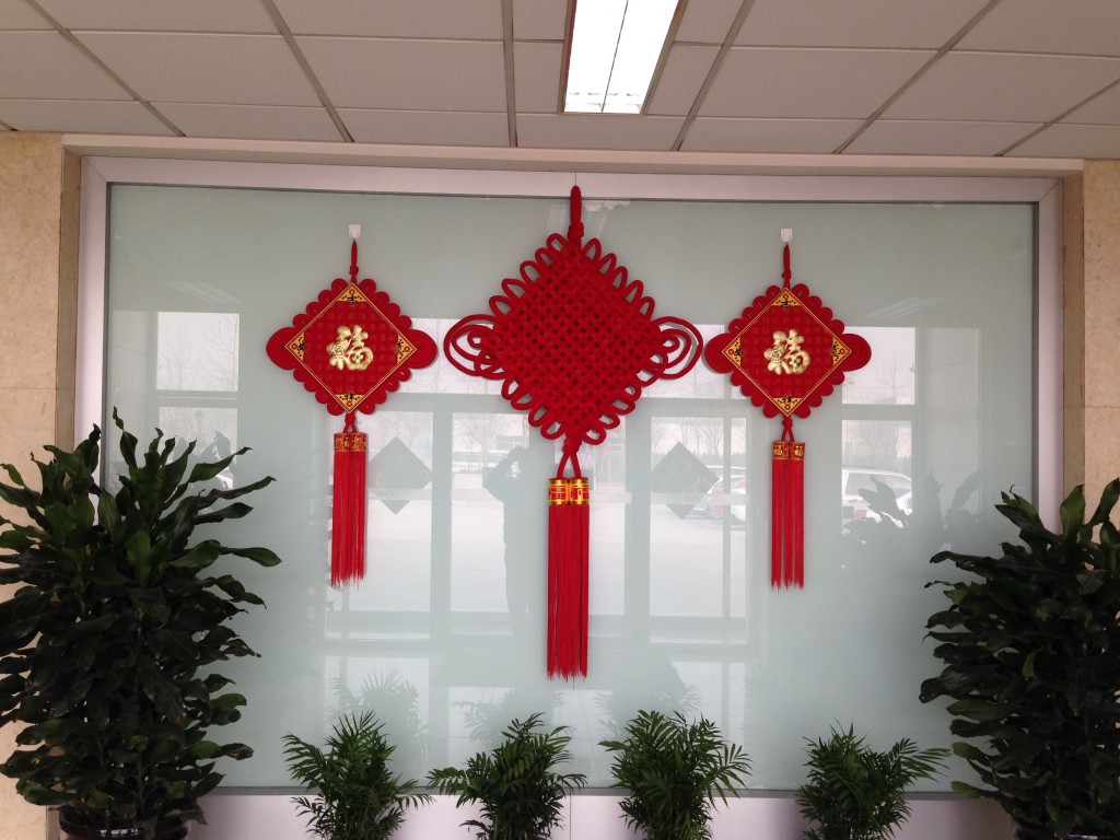 The entrance to every building, public and private alike, is adorned with wishes for prosperity and happiness.