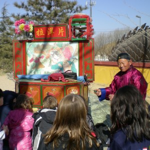 An old man recounts a traditional story in hopes that the children will carry on the traditions.