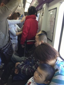 Young children and their mothers almost never stand on the crowded subways of Beijing.