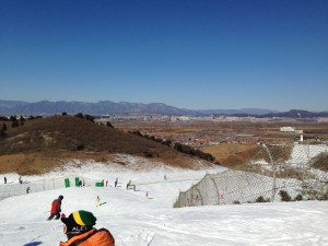 There are several ski areas within Beijing itself.  It's not the Alps but there are serious mountains a 2-3 hour drive away.