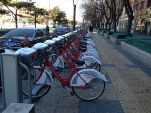In many ways Beijing is an eco-friendly city.  The government has provided 50,000 bicycles for rent.  Riders can pick up and drop off at any of the many stations that dot the downtown.