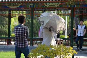 Umbrellas and parasols are common accessories but are more functional than fashionable.  Chinese women prefer to avoid the sun.