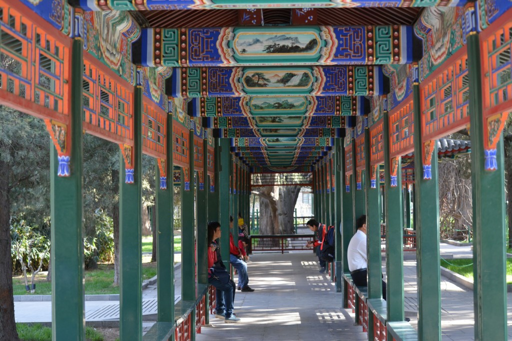 It could be just a walkway to protect against the elements.  In Chinese architecture, however, functionality doesn't preclude inspiration.