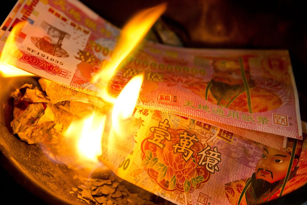 It is tradition during the Qingming Festival to burn symbolic money for the comfort and benefit of deceased ancestors.