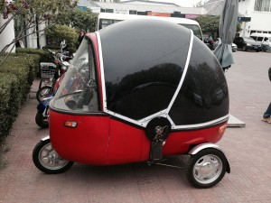 """Vehicles like this are common in Beijing.  But they would never be declared """"street-worthy"""" (i.e., legal) in developed countries like the U.S."""