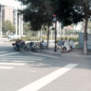 The Chinese are a social society.  When I leave work on a pleasant afternoon there are often elderly men who have assembled on the street corner just to be together and watch the world.