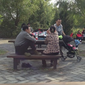 The Chinese know how to work.  But they also know how to take time out to talk.  This family, like so many families, is deep in a public park simply enjoying the comfort of each other's company.