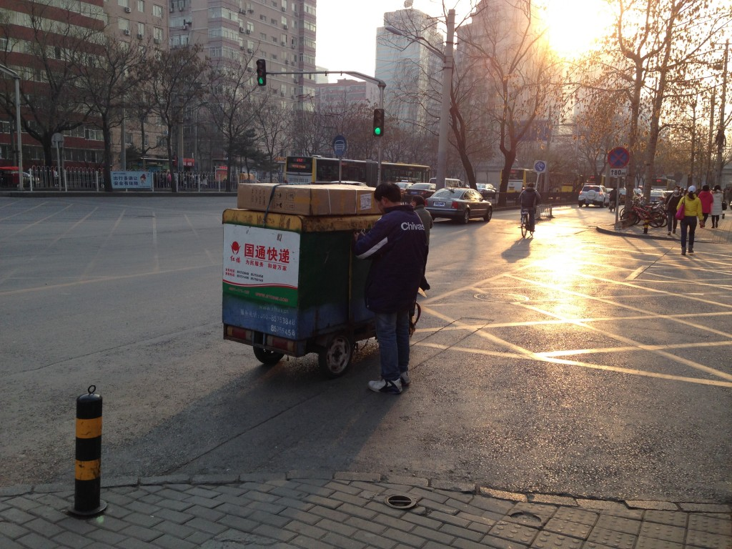 Part of the reason that e-commerce in China is reshaping the retail landscape is the low cost of delivery.  Your package will probably be delivered by someone driving a vehicle like this but it will get there and it will be cheap.  (That's probably a flat screen tv tied down to the top.)