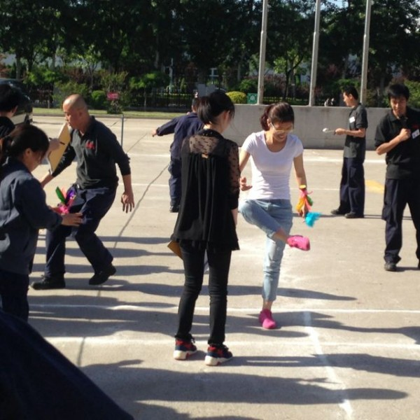 If there is a national sport of China I think of it as the Chinese version of hacky sack, known as Jianzi, using a weighted shuttlecock.  EVERYONE does it - young and old alike.  Bus drivers and taxi drivers are on a break and they inevitably pull out the Jianzi.