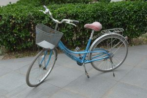 Most bicycles in China are simple in design: one gear, a luggage rack, and a front basket.